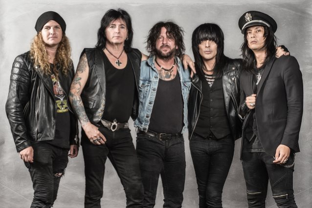 """Phil Lewis of L.A. Guns – """"We're not in it for themoney""""."""